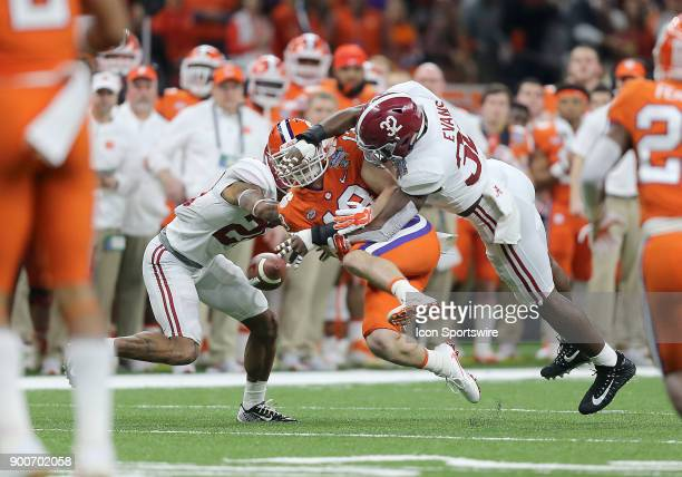 Alabama Crimson Tide linebacker Rashaan Evans breaks up a pass to Clemson Tigers wide receiver Hunter Renfrow during the College Football Playoff...