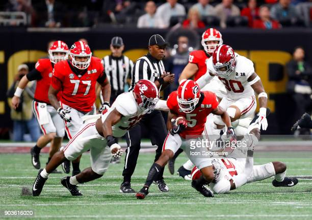 Alabama Crimson Tide linebacker Rashaan Evans tackles Georgia Bulldogs wide receiver Terry Godwin during the College Football Playoff National...