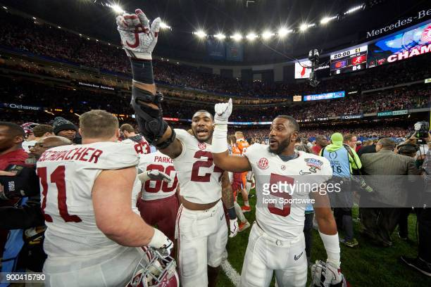 Alabama Crimson Tide linebacker Terrell Lewis and Alabama Crimson Tide defensive back Shyheim Carter celebrate with fans and teammates after the...