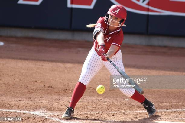 Alabama Crimson Tide outfielder KB Sides hits the ball during a college softball game between the Alabama Crimson Tide and the Cal State Fullerton...