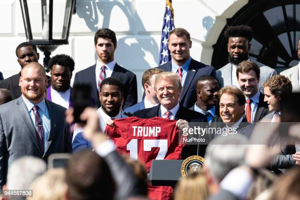 Alabama Crimson Tide players present US President Donald Trump with a commemorative jersey with his name on it at the White House celebration of...