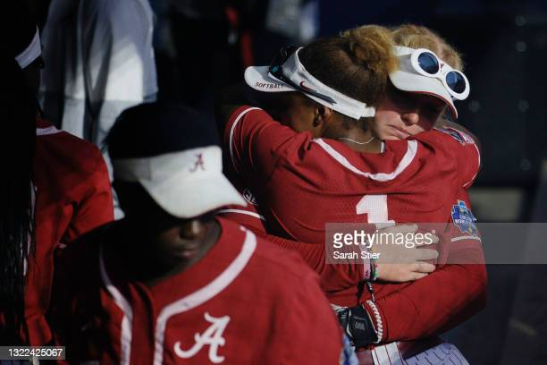 Alabama Crimson Tide players react after their loss during the seventh inning of Game 14 of the Women's College World Series against Florida St. On...
