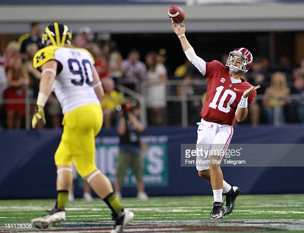 Alabama Crimson Tide quarterback AJ McCarron throws to wide receiver DeAndrew White for a touchdown in the first quarter against the Michigan...