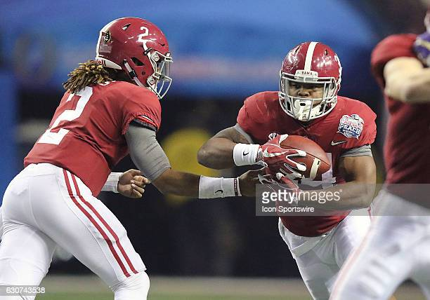 Alabama Crimson Tide quarterback Jalen Hurts hands the ball to running back Damien Harris during the 2016 ChickfilA Peach Bowl between the Alabama...