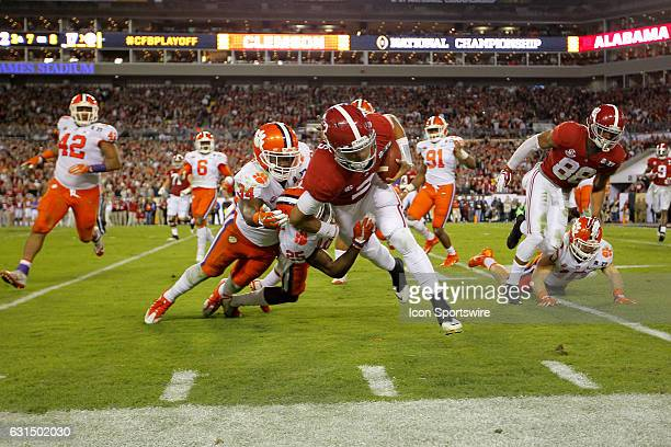 Alabama Crimson Tide quarterback Jalen Hurts is tackled by Clemson Tigers linebacker Kendall Joseph during second half action of the National...