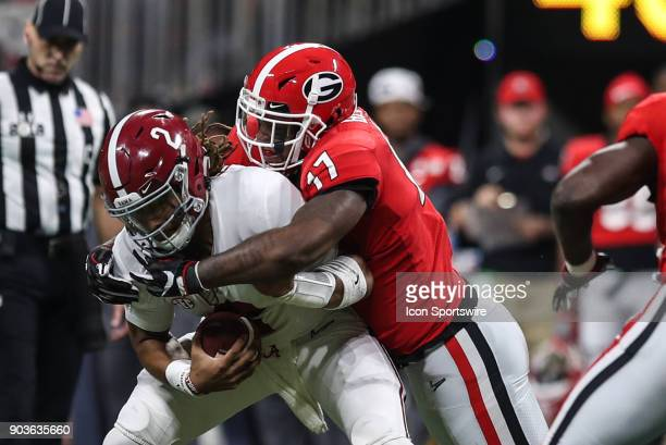 Alabama Crimson Tide quarterback Jalen Hurts is tackled by Georgia Bulldogs linebacker Davin Bellamy during the College Football Playoff National...