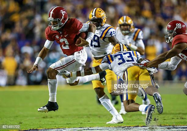 Alabama Crimson Tide quarterback Jalen Hurts leaps to avoid the tackle of LSU Tigers safety Jamal Adams during the game between the Alabama Crimson...