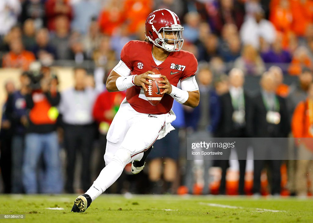 Alabama Crimson Tide quarterback Jalen Hurts (2) rolls out to pass during first half action of the National Championship game between the Alabama Crimson Tide and Clemson Tigers on January 9, 2017, at Raymond James Stadium in Tampa, FL.