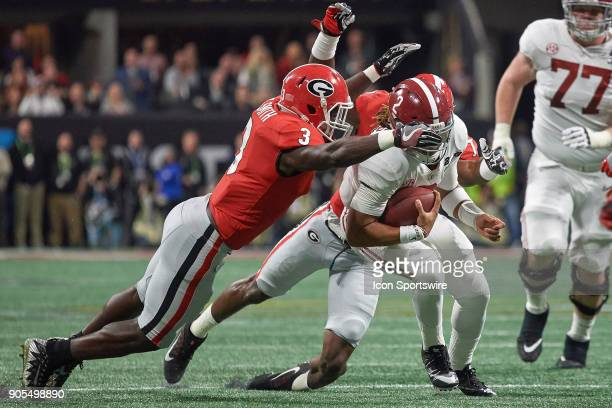 Alabama Crimson Tide quarterback Jalen Hurts runs with the football as he is chased by Georgia Bulldogs linebacker Roquan Smith and Georgia Bulldogs...
