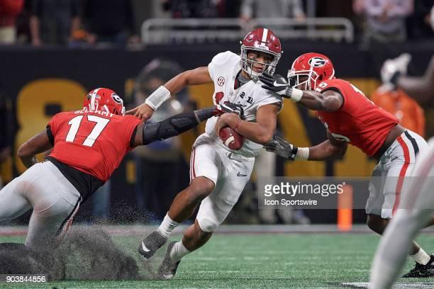 Alabama Crimson Tide quarterback Tua Tagovailoa battles with Georgia Bulldogs linebacker Davin Bellamy and Georgia Bulldogs linebacker D'Andre Walker...