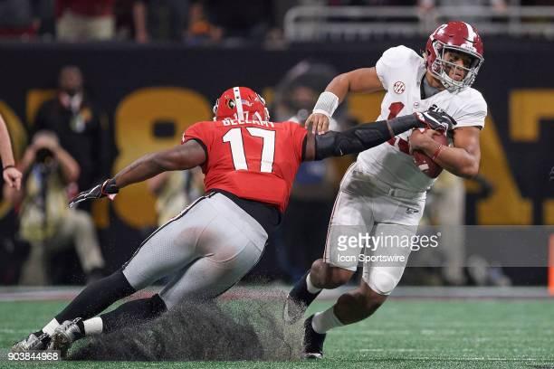 Alabama Crimson Tide quarterback Tua Tagovailoa battles with Georgia Bulldogs linebacker Davin Bellamy during the College Football Playoff National...