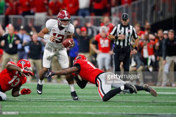 Alabama Crimson Tide quarterback Tua Tagovailoa is sacked by Georgia Bulldogs linebacker Davin Bellamy during the College Football Playoff National...