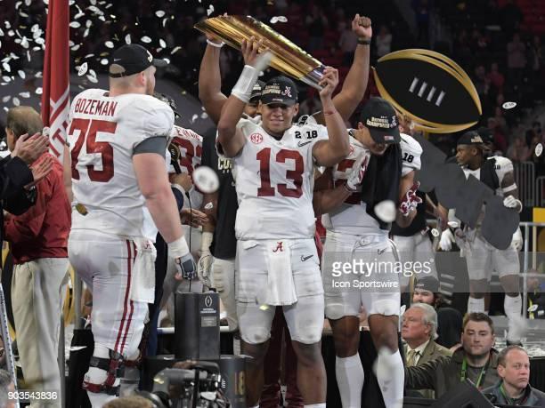 Alabama Crimson Tide quarterback Tua Tagovailoa lifts the College Football Playoff National Championship Trophy after the College Football Playoff...