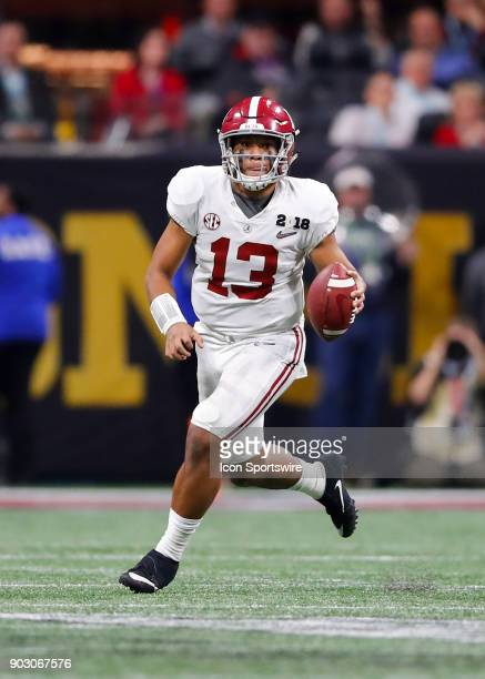 Alabama Crimson Tide quarterback Tua Tagovailoa rolls out to pass during the College Football Playoff National Championship Game between the Alabama...