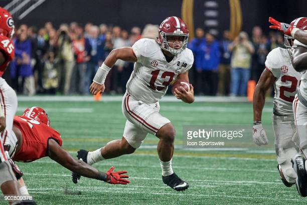 Alabama Crimson Tide quarterback Tua Tagovailoa runs with the football during the College Football Playoff National Championship Game between the...
