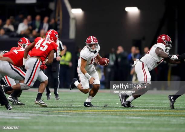 Alabama Crimson Tide quarterback Tua Tagovailoa scrambles during the College Football Playoff National Championship Game between the Alabama Crimson...