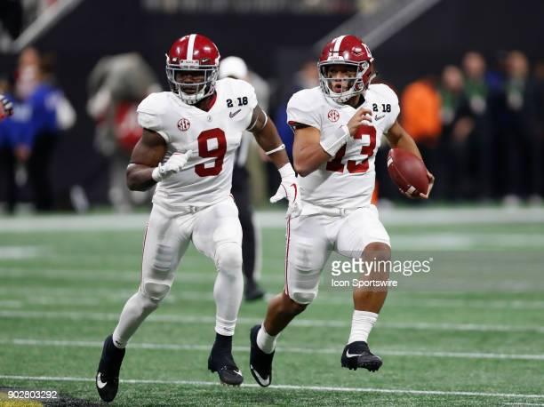 Alabama Crimson Tide quarterback Tua Tagovailoa takes off towards the outside line during the College Football Playoff National Championship Game...