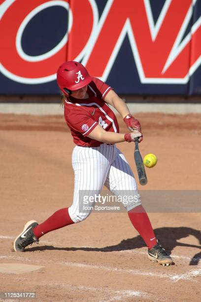 Alabama Crimson Tide Reagan Dykes hits the ball during a college softball game between the Alabama Crimson Tide and the Cal State Fullerton Titans on...