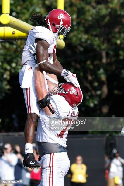 Alabama Crimson Tide running back Bo Scarbrough and Alabama Crimson Tide offensive tackle Matt Womack celebrate a touchdown during a college football...