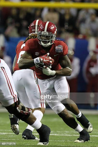 Alabama Crimson Tide running back Bo Scarbrough carries the ball in the College Football Playoff Semifinal at the ChickfilA Peach Bowl between the...