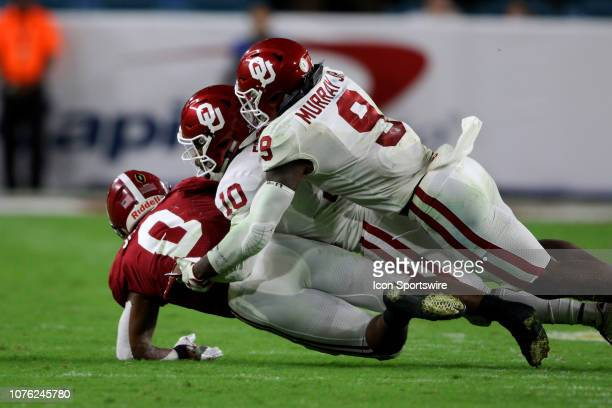 Alabama Crimson Tide running back Josh Jacobs is tackled by Oklahoma Sooners safety Patrick Fields and linebacker Kenneth Murray during the second...