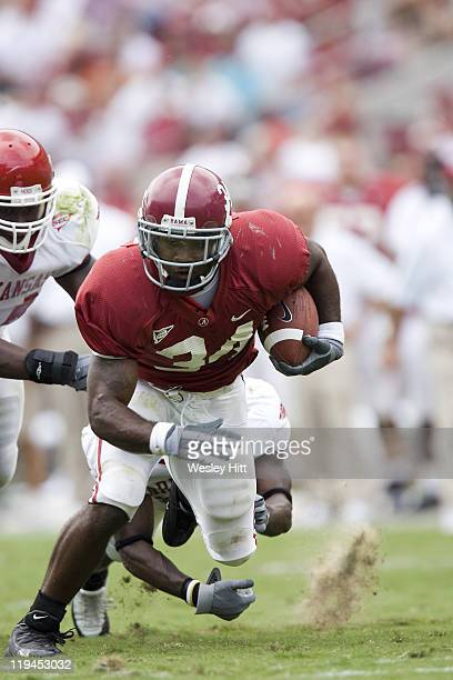 Alabama Crimson Tide running back Kenneth Darby avoids a tackle during a 24 to 13 win over the Arkansas Razorbacks on September 24 2005 at...