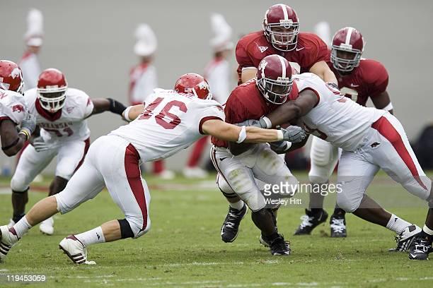 Alabama Crimson Tide running back Kenneth Darby gets tackled by Arkansas Razorback linebacker Clarke Moore during a 24 to 13 win over the Razorbacks...
