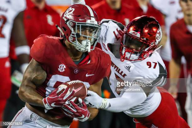Alabama Crimson Tide tight end Irv Smith Jr catches a pass and is tackled by Louisville Cardinals linebacker Nick Okeke during the football game...