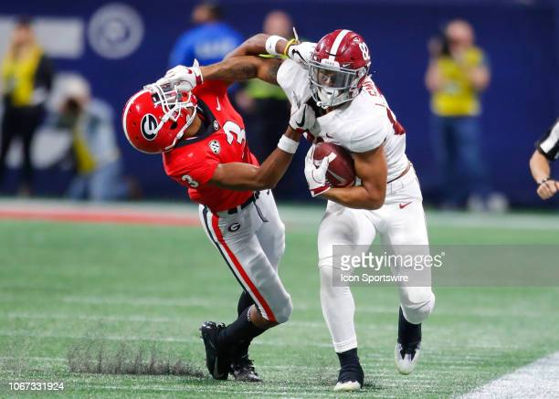 Alabama Crimson Tide tight end Irv Smith Jr stiff arms Georgia Bulldogs defensive back Tyson Campbell during the SEC Championship game of the Georgia...