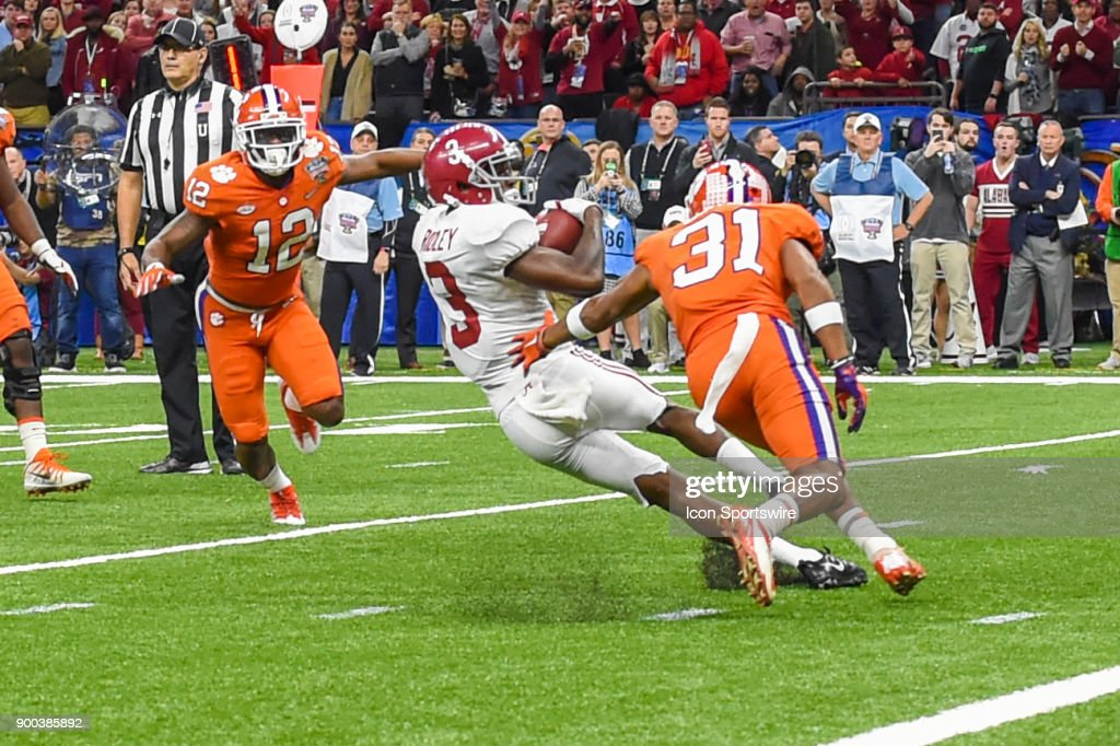 Alabama Crimson Tide wide receiver Calvin Ridley (3) attempts to spin out of a tackle attempt by Clemson Tigers cornerback Ryan Carter (31) after an early second half pass reception during the College Football Playoff Semifinal at the Allstate Sugar Bowl between the Alabama Crimson Tide and Clemson Tigers on January 1, 2018, at the Mercedes-Benz Superdome in New Orleans, LA.
