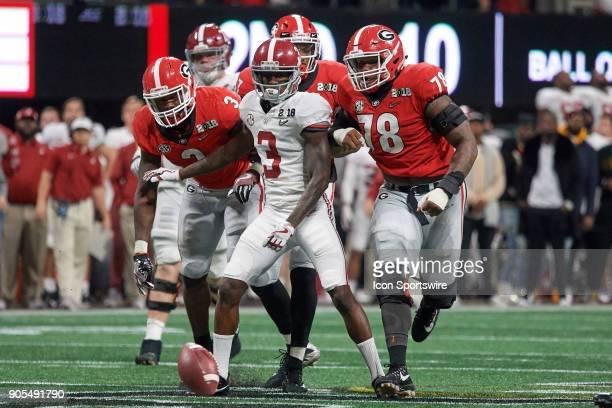 Alabama Crimson Tide wide receiver Calvin Ridley battles with Georgia Bulldogs linebacker Roquan Smith Georgia Bulldogs linebacker Lorenzo Carter and...