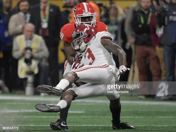 Alabama Crimson Tide wide receiver Calvin Ridley falls to the ground after Georgia Bulldogs defensive back JR Reed tackles him during the College...