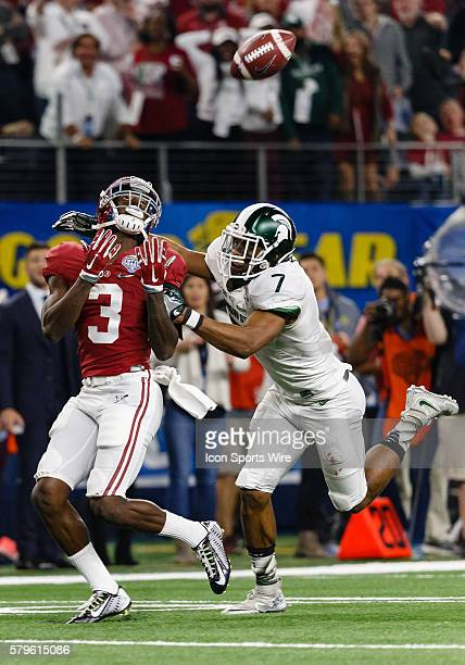 Alabama Crimson Tide wide receiver Calvin Ridley makes a long reception over Michigan State Spartans defensive back Demetrious Cox during the NCAA...