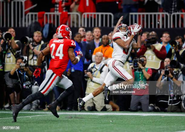 Alabama Crimson Tide wide receiver DeVonta Smith catches the winning touchdown over Georgia Bulldogs safety Dominick Sanders during the College...