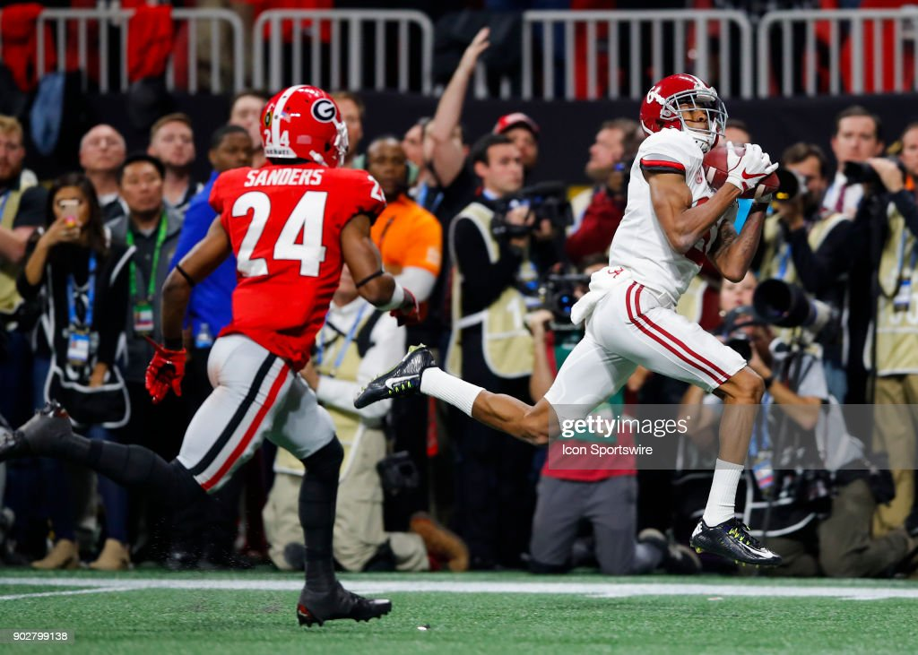 Alabama Crimson Tide wide receiver DeVonta Smith (6) catches the winning touchdown over Georgia Bulldogs safety Dominick Sanders (24) during the College Football Playoff National Championship Game between the Alabama Crimson Tide and the Georgia Bulldogs on January 8, 2018 at Mercedes-Benz Stadium in Atlanta, GA. The Alabama Crimson Tide won the game in overtime 26-23.