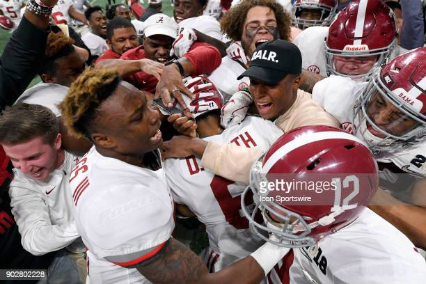Alabama Crimson Tide wide receiver DeVonta Smith celebrates with teammates after catching the gamewinning touchdown in overtime during the College...