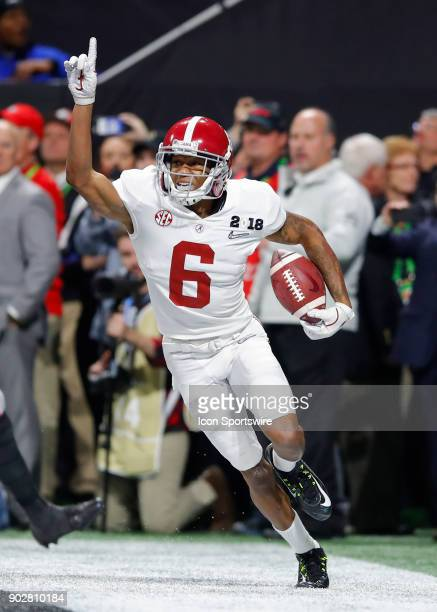 Alabama Crimson Tide wide receiver DeVonta Smith reacts after catching the winning touchdown during the College Football Playoff National...