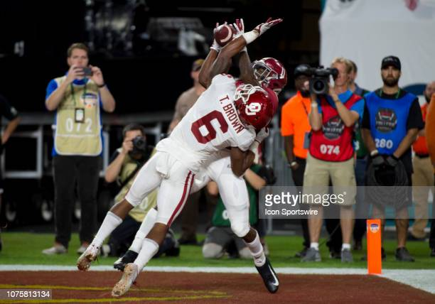 Alabama Crimson Tide wide receiver Henry Ruggs III catches a pass for a touchdown as Oklahoma Sooners cornerback Tre Brown defends during the College...