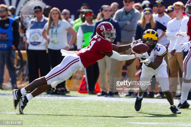 Alabama Crimson Tide wide receiver Henry Ruggs III reaches out to catch a pass during the VRBO Citrus Bowl between The Alabama Crimson Tide and the...