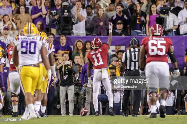 Alabama Crimson Tide wide receiver Henry Ruggs III scores the first touchdown of the game against LSU Tigers on November 3 at Tiger Stadium in Baton...
