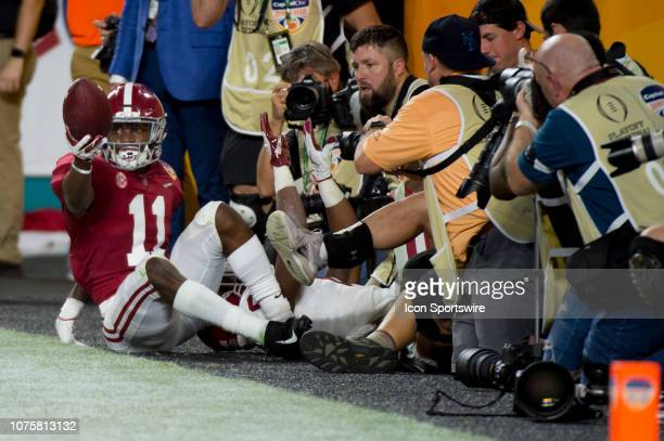 Alabama Crimson Tide wide receiver Henry Ruggs III shows the ball to the official after catching a touchdown pass during the College Football Playoff...