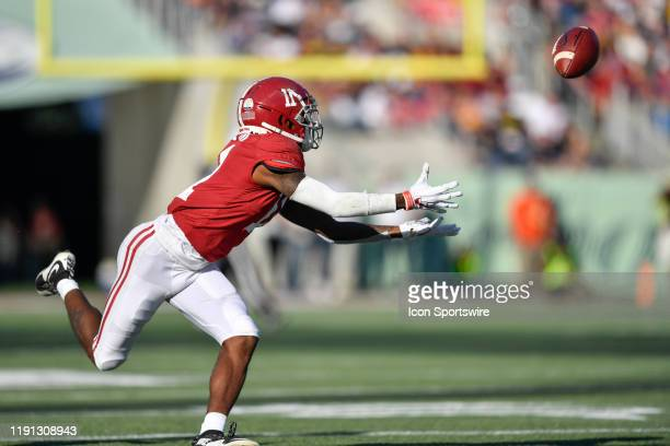 Alabama Crimson Tide wide receiver Henry Ruggs III tries to make a diving catch during the second half of the Citrus Bowl between the Michigan...