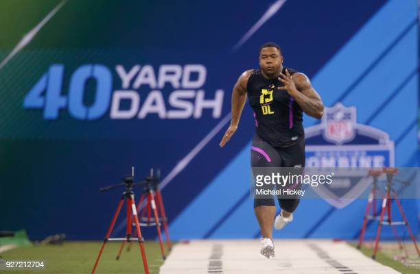 Alabama defensive lineman Da'ron Payne runs in the 40 yard dash at Lucas Oil Stadium on March 4 2018 in Indianapolis Indiana