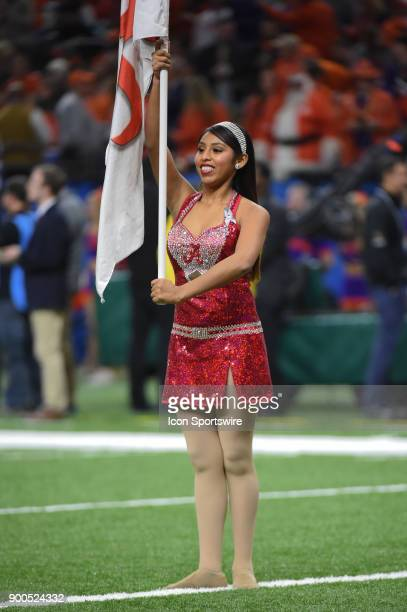 Alabama flag bearers perform before the College Football Playoff Semifinal at the Allstate Sugar Bowl between the Alabama Crimson Tide and Clemson...