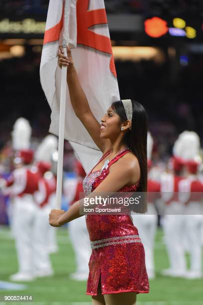 Alabama flag bearers perform with the marching band before the College Football Playoff Semifinal at the Allstate Sugar Bowl between the Alabama...