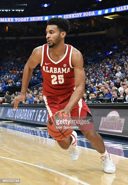 Alabama forward Braxton Key drives to the basket in the second half during a Southeastern Conference Basketball Tournament game between the Kentucky...