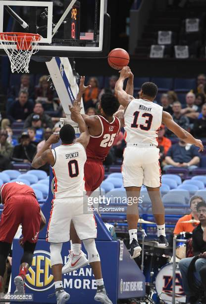 Alabama forward Braxton Key falls backward as he puts up a shot ion the first half during a Southeastern Conference Basketball Tournament game...