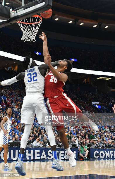 Alabama forward Braxton Key is fouled by Kentucky forward Wenyen Gabriel as he puts up a shot during a Southeastern Conference Basketball Tournament...