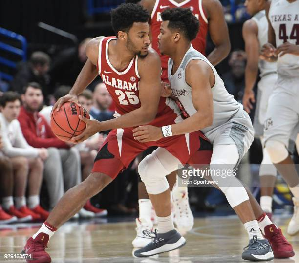 Alabama forward Braxton Key is guarded closely by Texas AM guard Admon Gilder during a Southeastern Conference Basketball Tournament game between...