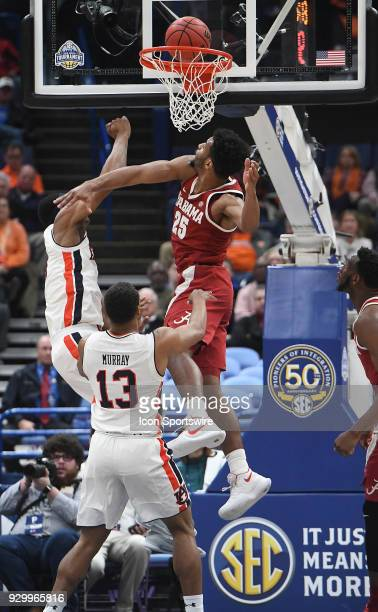 Alabama forward Braxton Key misses blocking a shot by Auburn forward Daniel Purifoy during a Southeastern Conference Basketball Tournament game...